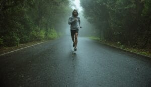 Marathon runner on dark road